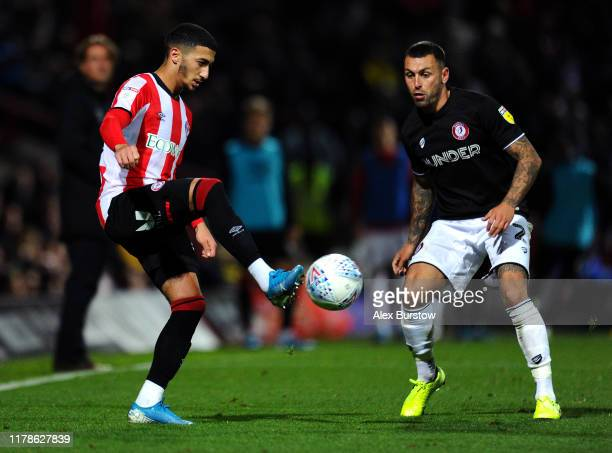 Said Benrahma of Brentford passes the ball under pressure from Jack Hunt of Bristol City during the Sky Bet Championship match between Brentford and...