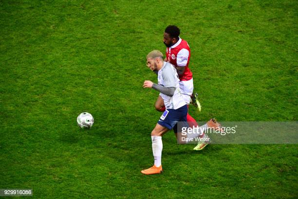 Said Benrahma of Chateauroux and Romain Metanire of Reims during the French Ligue 2 match between Reims and Chateauroux at Stade Auguste Delaune on...