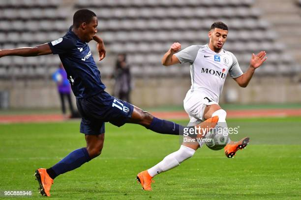Said Benrahma of Chateauroux and Samuel Yohou of Paris FC during the French Ligue 2 match between Paris FC and Chateauroux at Stade Charlety on April...