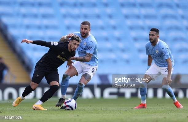 Said Benrahma of West Ham United is challenged by Kyle Walker of Manchester City during the Premier League match between Manchester City and West Ham...