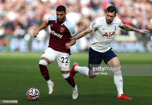 Said Benrahma of West Ham United is challenged by Pierre-Emile Hojbjerg of Tottenham Hotspur during the Premier League match between West Ham United...