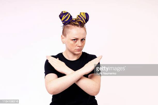 i said, no. frustrated woman shows her crossed arms in gesture sign and looks on camera. stop sign. the woman has hairdo and dreadlocks on her head, freckles on her face. - 十字形 ストックフォトと画像