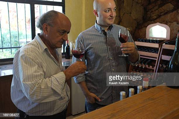 Said Tanios Touma seen with his father Joe who owns Clos St Thomas wines seen while tasting one of their red wines on August 4 2012 in Bekaa Lebanon...
