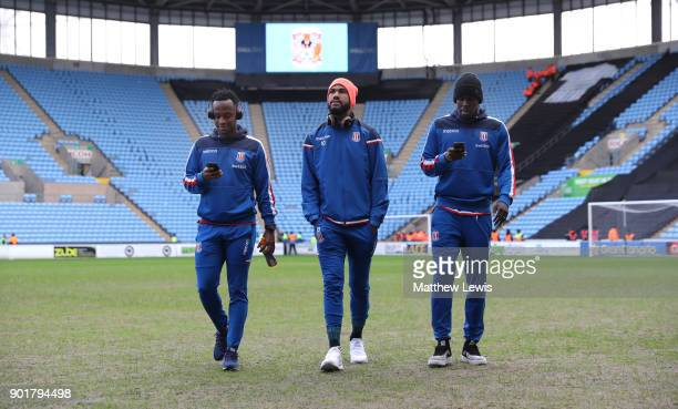 Saido Berahino Maxim ChoupoMoting and Kurt Zouma of Stoke City inspect the pitch prior to The Emirates FA Cup Third Round match between Coventry City...