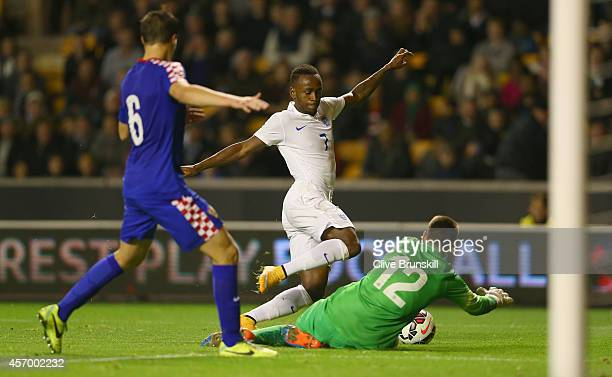 Saido Berahino of England is fouled by Dominik Livakovic of Croatia to be awarded a penalty which he scored to win the match during the UEFA U21...