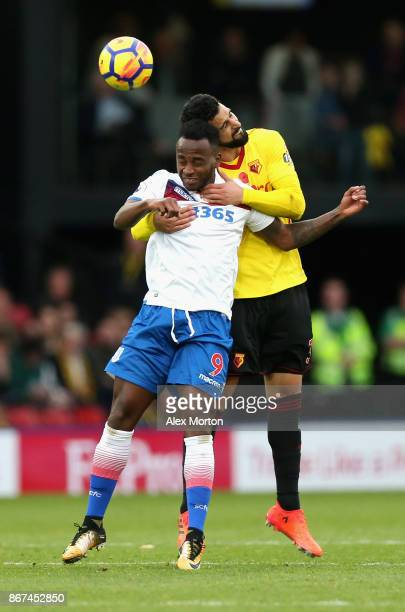Saido Berahino of Stoke City and Miguel Britos of Watford in action during the Premier League match between Watford and Stoke City at Vicarage Road...
