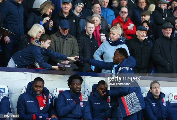 Saido Berahino of Stoke City signs autographs for fans prior to the Premier League match between West Bromwich Albion and Stoke City at The Hawthorns...