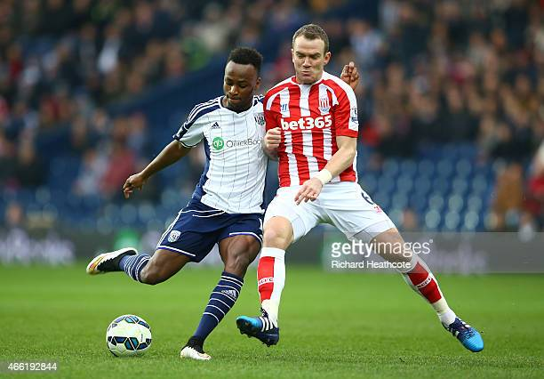 Saido Berahino of West Brom and Glenn Whelan of Stoke City during the Barclays Premier League match between West Bromwich Albion and Stoke City at...