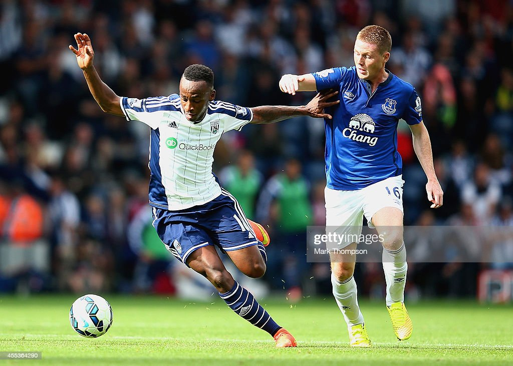 Saido Berahino of West Brom is challenged by James McCarthy of Everton during the Barclays Premier League match between West Bromwich Albion and Everton at The Hawthorns on September 13, 2014 in West Bromwich, England.