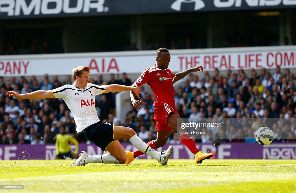 Saido Berahino of West Brom scores a disallowed goal as Eric Dier of Spurs closes in during the Barclays Premier League match between Tottenham Hotspur and West Bromwich Albion at White Hart Lane on September 21, 2014 in London, England.