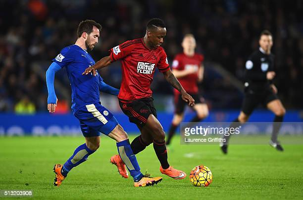 Saido Berahino of West Bromwich Albion and Christian Fuchs of Leicester City compete for the ball during the Barclays Premier League match between...