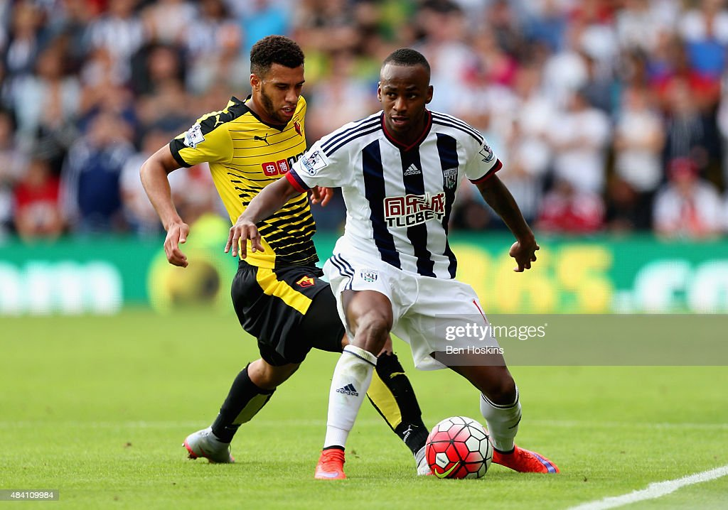 Saido Berahino of West Bromwich Albion and Etienne Capoue of Watford compete for the ball during the Barclays Premier League match between Watford and West Bromwich Albion at Vicarage Road on August 15, 2015 in Watford, United Kingdom.