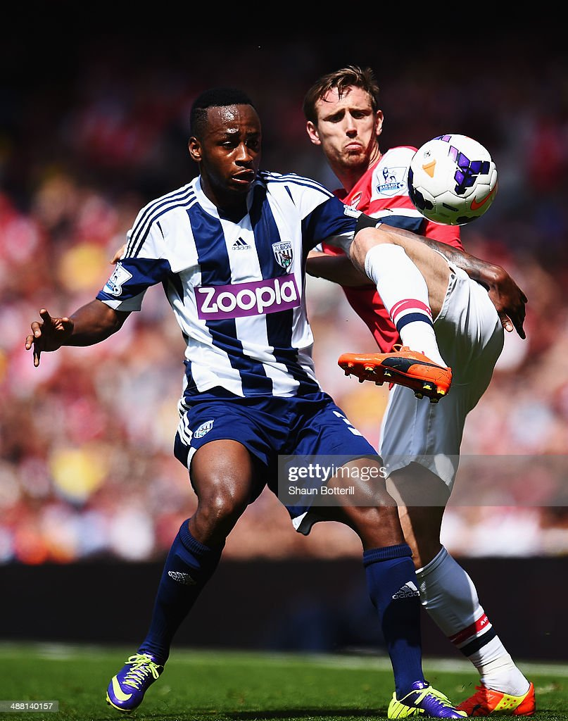 Saido Berahino of West Bromwich Albion and Nacho Monreal of Arsenal challenge for the ball during the Barclays Premier League match between Arsenal and West Bromwich Albion at the Emirates Stadium on May 4, 2014 in London, England.
