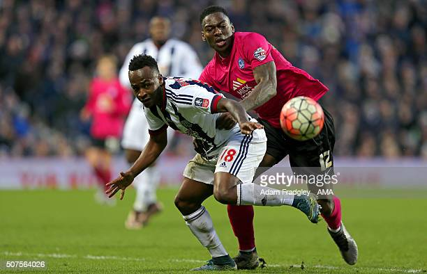Saido Berahino of West Bromwich Albion and Ricardo Santos of Peterborough United during the Emirates FA Cup match between West Bromwich Albion and...