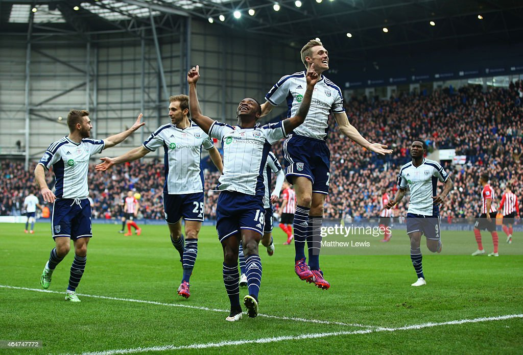 Saido Berahino of West Bromwich Albion (18) celebrates with Darren Fletcher (24) and team mates as he scores their first goal during the Barclays Premier League match between West Bromwich Albion and Southampton at The Hawthorns on February 28, 2015 in West Bromwich, England.