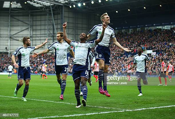 Saido Berahino of West Bromwich Albion celebrates with Darren Fletcher and team mates as he scores their first goal during the Barclays Premier...