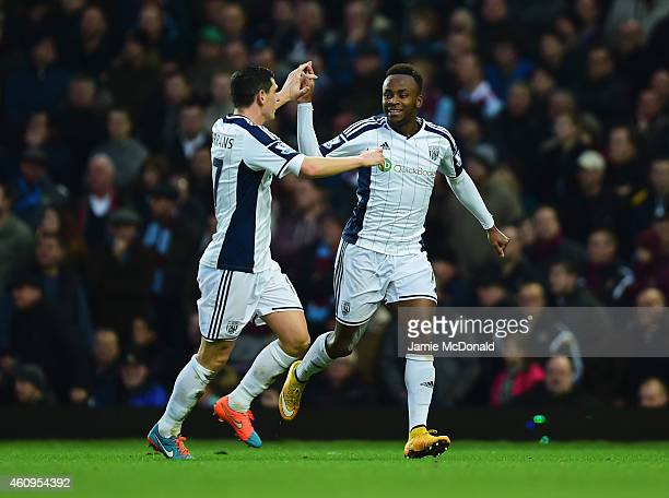 Saido Berahino of West Bromwich Albion celebrates with Graham Dorrans as he scores their first goal during the Barclays Premier League match between...