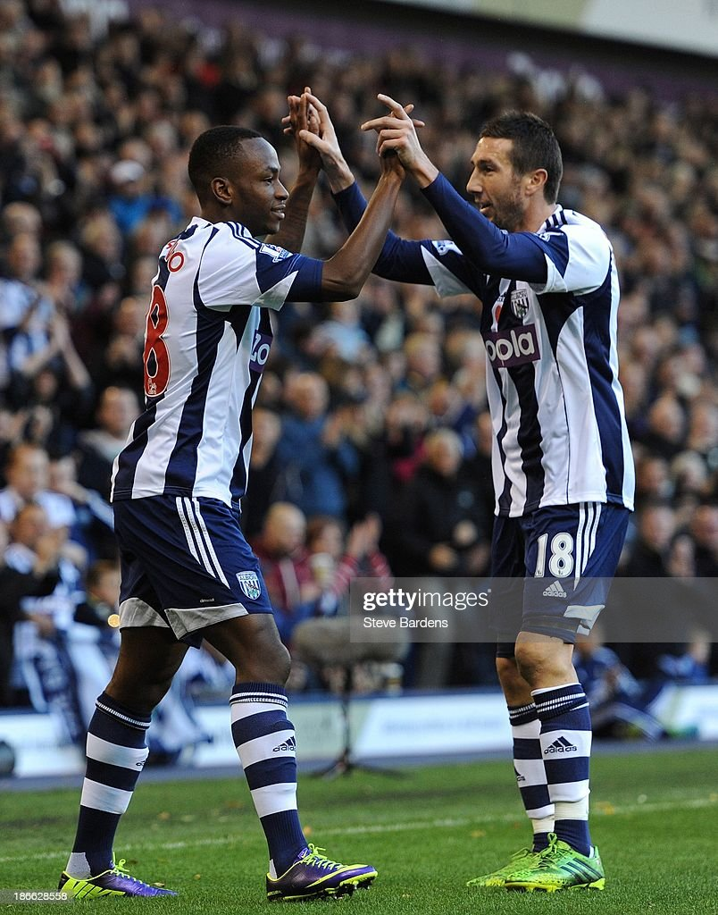 Saido Berahino (L) of West Bromwich Albion celebrates with Morgan Amalfitano after scoring the opening goal during the Barclays Premier League match between West Bromwich Albion and Crystal Palace at The Hawthorns on November 2, 2013 in West Bromwich, England.