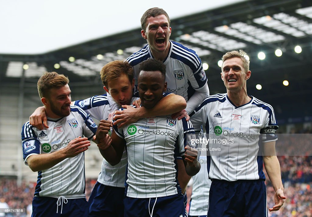 Saido Berahino of West Bromwich Albion (front) celebrates with team mates as he scores their first goal during the Barclays Premier League match between West Bromwich Albion and Southampton at The Hawthorns on February 28, 2015 in West Bromwich, England.