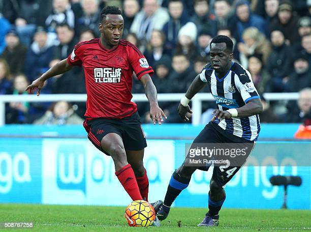 Saido Berahino of West Bromwich Albion is chased by Cheick Tiote of Newcastle United during the Barclays Premier League match between Newcastle...