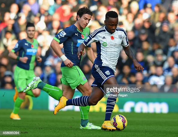 Saido Berahino Of West Bromwich Albion Is Chased By Daryl