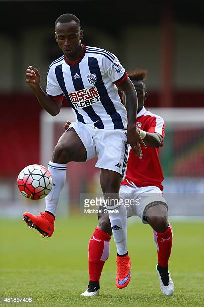 Saido Berahino of West Bromwich Albion lays the ball off as Drissa Traore of Swindon Town closes in during the Pre-Season Friendly match between...