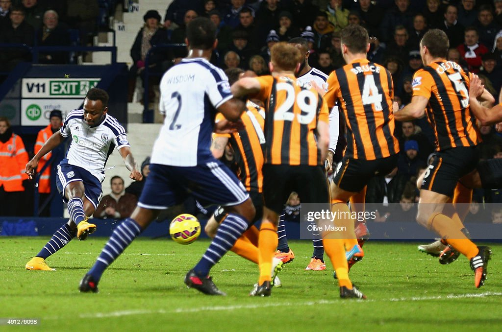 Saido Berahino of West Bromwich Albion (L) scores their first goal from a free kick during the Barclays Premier League match between West Bromwich Albion and Hull City at The Hawthorns on January 10, 2015 in West Bromwich, England.
