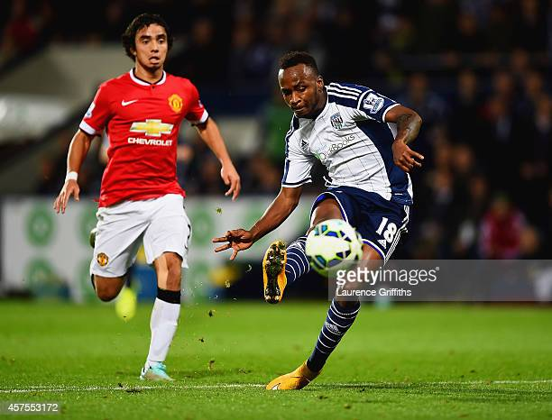 Saido Berahino of West Bromwich Albion scores their second goal as Rafael of Manchester United looks on during the Barclays Premier League match...