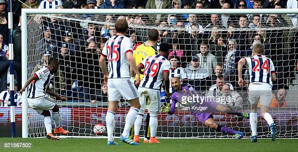 Saido Berahino of West Bromwich Albion sees his penalty saved by Heurelho Gomes of Watford during the Barclays Premier League match between West...