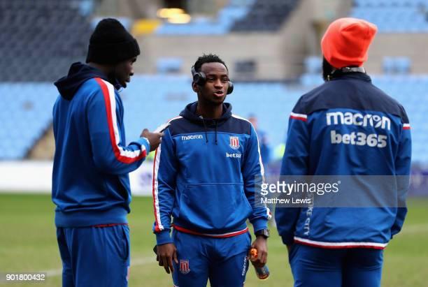 Saido Berahino talks with team mates Kurt Zouma and Maxim ChoupoMoting of Stoke City prior to The Emirates FA Cup Third Round match between Coventry...