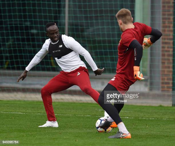 Saido Mane and Simon Mignolet of Liverpool during a training session at Melwood Training Ground on April 12 2018 in Liverpool England