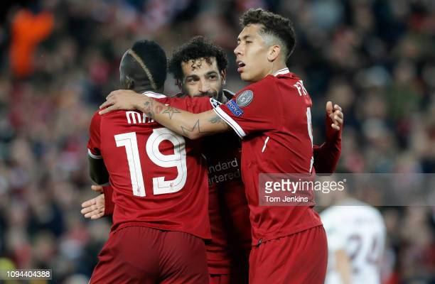 Saido Mane, Mo Salah and Roberto Firmino celebrate after the 3rd Liverpool goal scored by Mane during the Liverpool v Roma Champions League...