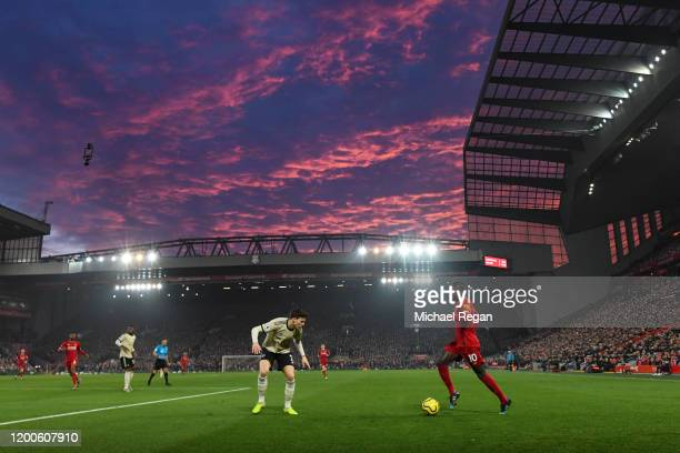 Saido Mane of Liverpool in action as the sun sets during the Premier League match between Liverpool FC and Manchester United at Anfield on January...