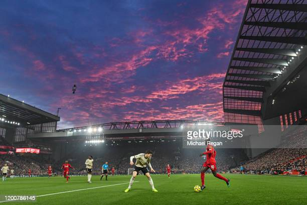 Saido Mane of Liverpool in action as the sun sets during the Premier League match between Liverpool FC and Manchester United at Anfield on January 19...