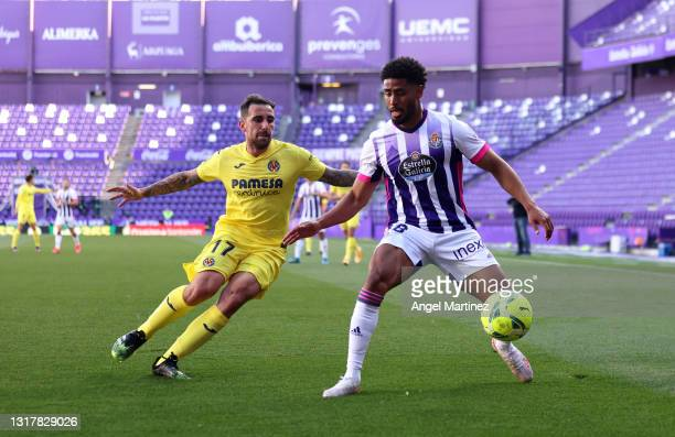 Saidy Janko of Real Valladolid battles for possession with Paco Alcacer of Villarreal CF during the La Liga Santander match between Real Valladolid...