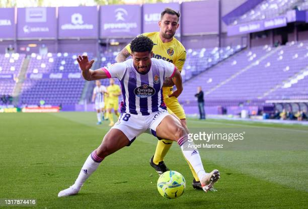 Saidy Yanko of Real Valladolid is challenged by Paco Alcacer of Villarreal CF during the La Liga Santander match between Real Valladolid CF and...