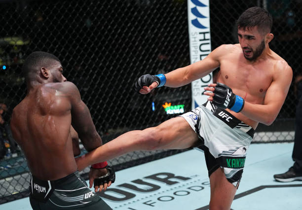 Saidyokub Kakhramonov of Uzbekistan kicks Trevin Jones of Guam in a bantamweight fight during the UFC Fight Night event at UFC APEX on August 21,...