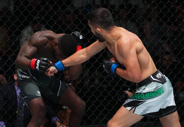 Saidyokub Kakhramonov of Uzbekistan punches Trevin Jones of Guam in a bantamweight fight during the UFC Fight Night event at UFC APEX on August 21,...