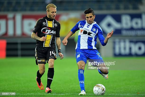 Saief Kenneth of KAA Gent is challenged by Remacle Jordan of Sporting Lokeren during the Cofidis Cup 1/4 final second leg match between KAA Gent and...