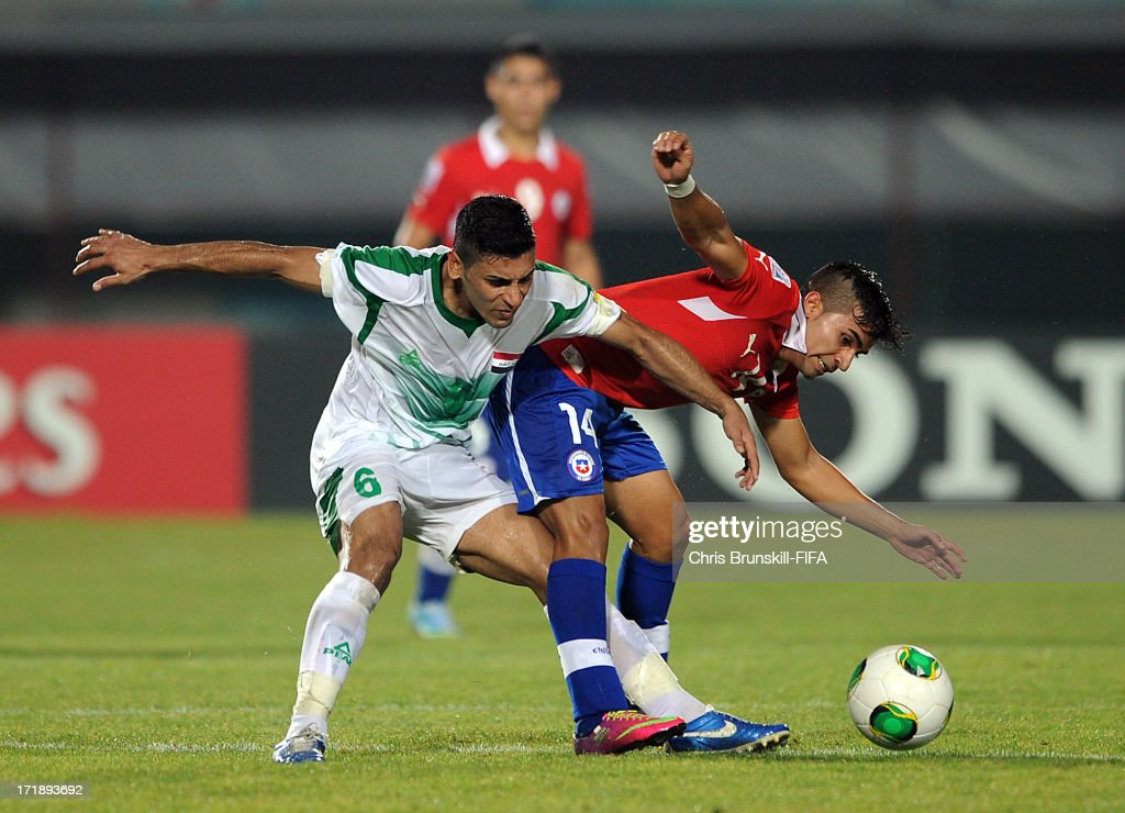 Saif Salman (L) of Iraq in action with Bryan Rabello of Chile during the FIFA U20 World Cup Group E match between Iraq and Chile at Akdeniz University Stadium on June 29, 2013 in Antalya, Turkey.