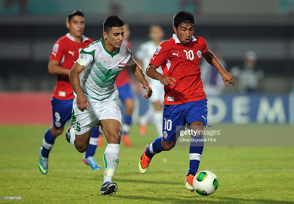 Saif Salman (L) of Iraq in action with Nicolas Maturana of Chile during the FIFA U20 World Cup Group E match between Iraq and Chile at Akdeniz University Stadium on June 29, 2013 in Antalya, Turkey.