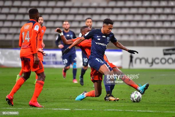 Saifeddine Alami Bazza of Paris FC and Christopher Martins Pereira of FBBP 01 during the Ligue 2 match between Paris FC and Bourg en Bresse at Stade...