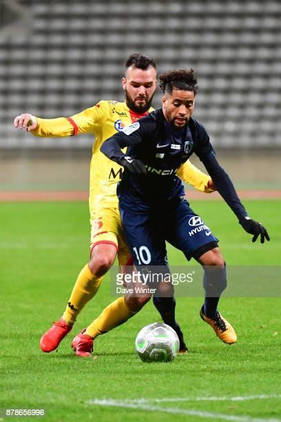 Saifeddine Alami Bazza of Paris FC and Stanislas Oliveira of Quevilly Rouen Metropole during the Ligue 2 match between Paris FC and Quevilly Rouen...