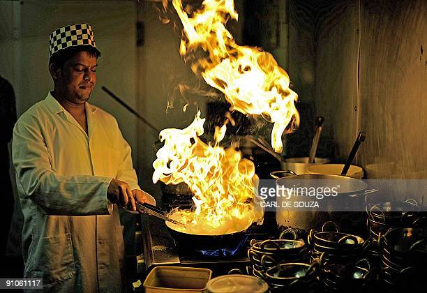 Saiful Islam a chef in an Indian restaurant on Brick Lane in east London is pictured at work on September 23 2009 The annual Brick Lane Curry...