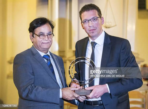 SaifulMalook Pakistani lawyer of Asia Bibi receives an award during a prayer service in the Great Church of Vianen on November 8 2018 for the...