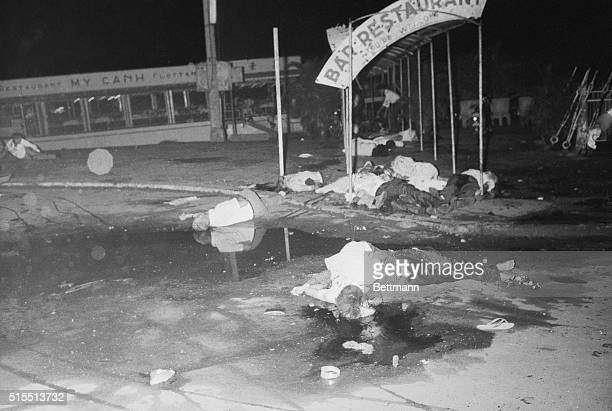 A Floating Nightmare Shattered bodies lie sprawled about at the entrance area of a floating restaurant here June 25th after two Viet Cong bombs...