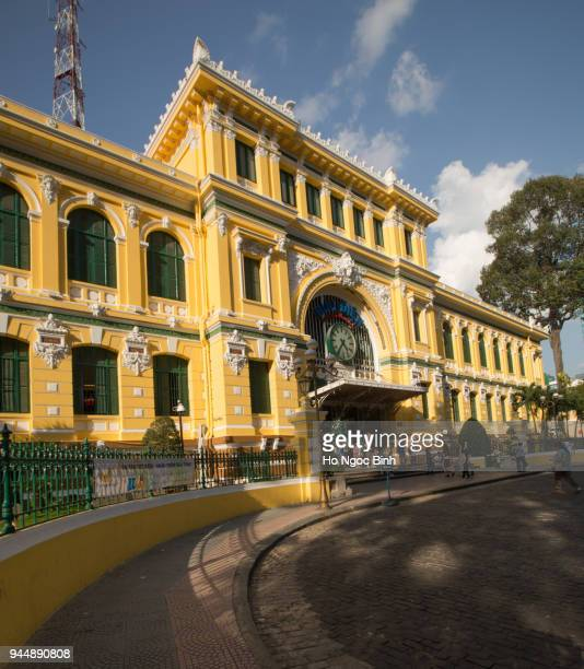 Saigon Central Post Office on blue sky background in Ho Chi Minh, Vietnam. Steel structure of the gothic building was designed by Gustave Eiffel. Ho Chi Minh is a popular tourist destination of Asia. Purchase a license This image is for editorial use onl