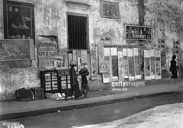 Saigon French Indochina Sale of wishes for the New Year in the streets probably in the 1910s