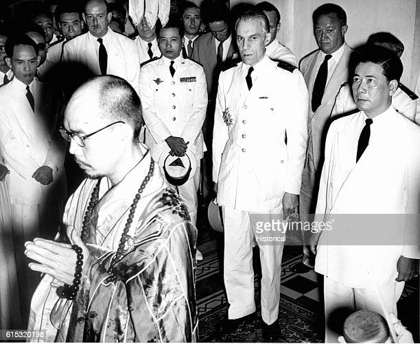 Saigon President Ngo Dinh Diem of free Vietnam and General Paul Ely French High Commissioner enter the Pagoda HungLong Cholon to attend Buddhist...