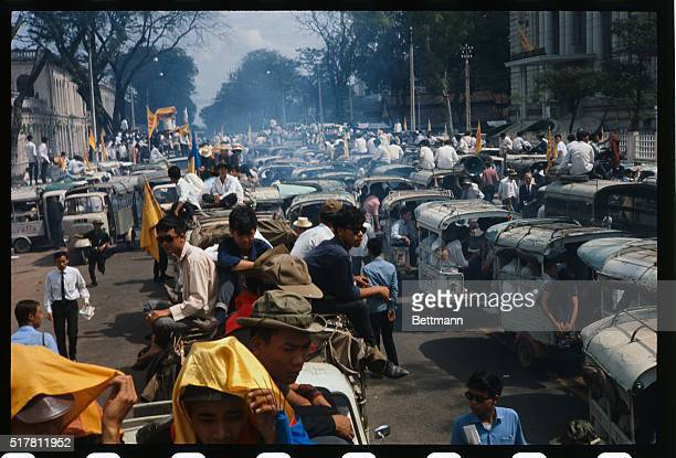 Saigon South VietnamVietnamese demonstrators protesting the halt in the US bombing of North Vietnam parade with a sign during a demonstration near...